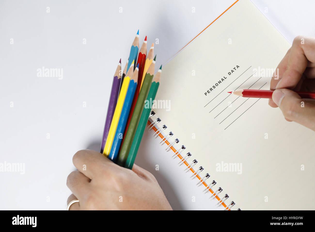 Pencil writting on notebook on white background - Stock Image