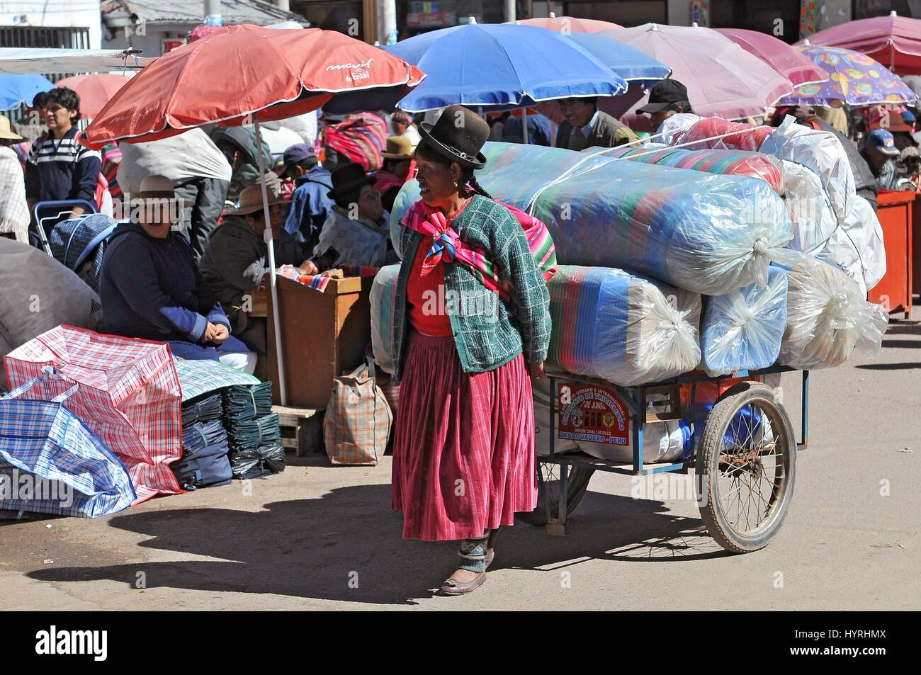 Peru, the border of Bolivia and Peru, Woman Carryng Stock Photo