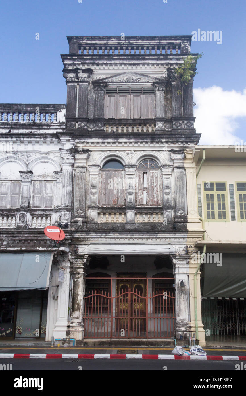 Unrestored sino portuguese architecture shophouse in old Phuket Town, Thailand - Stock Image