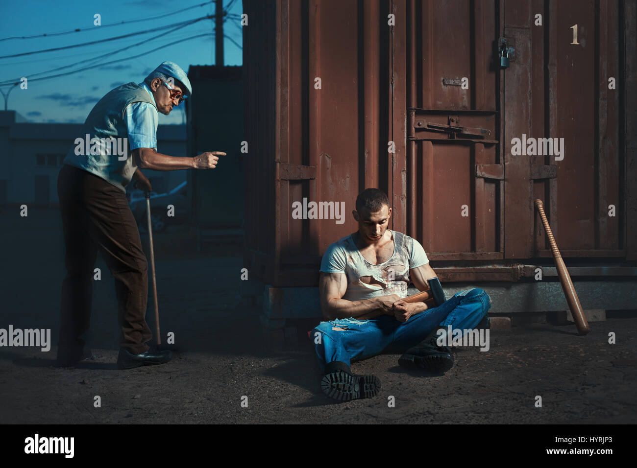 Old man in the street at night hit extortionists. - Stock Image