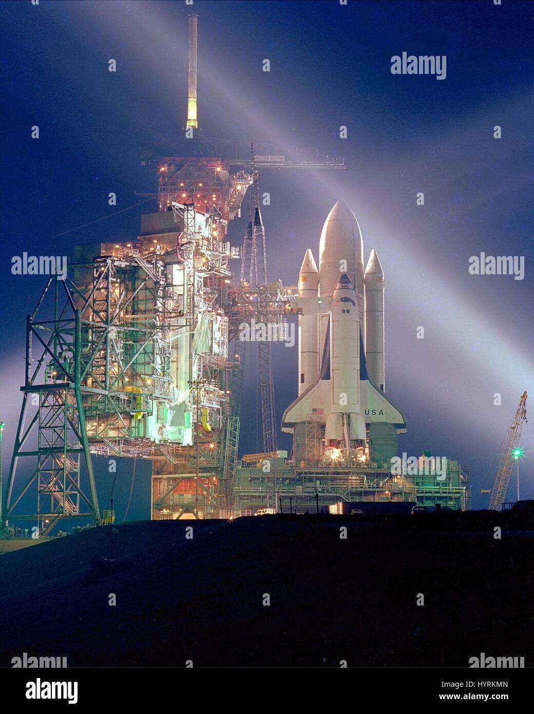 The NASA space shuttle Columbia sits on the Kennedy Space Center Launch Pad 39A at night in preparation for its - Stock Image