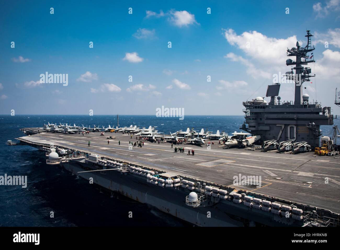 The USN Nimitz-class aircraft carrier USS Carl Vinson steams underway March 2, 2017 in the South China Sea. - Stock Image