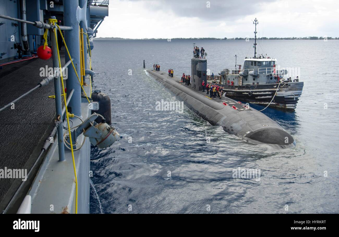 The USN Los Angeles-class fast-attack submarine USS Pasadena surfaces alongside the USN Emory S. Land-class submarine - Stock Image