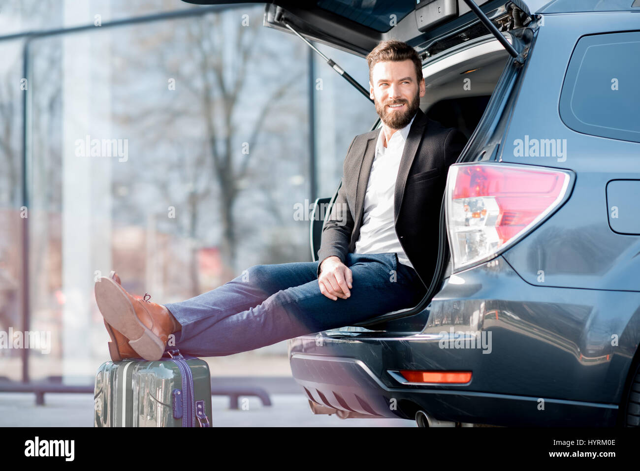 Businessman traveling by car - Stock Image