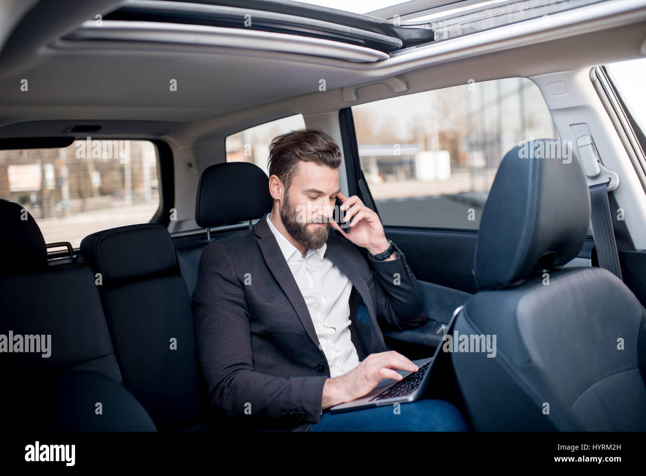 Businessman in the car - Stock Image
