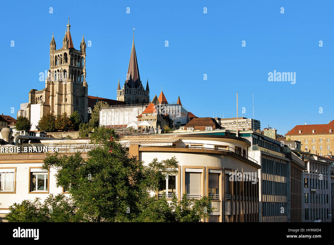 Lausanne, Switzerland - August 26, 2016: Cathedral of Notre Dame, Lausanne, in Switzerland. Seen from Le Flon district - Stock Image
