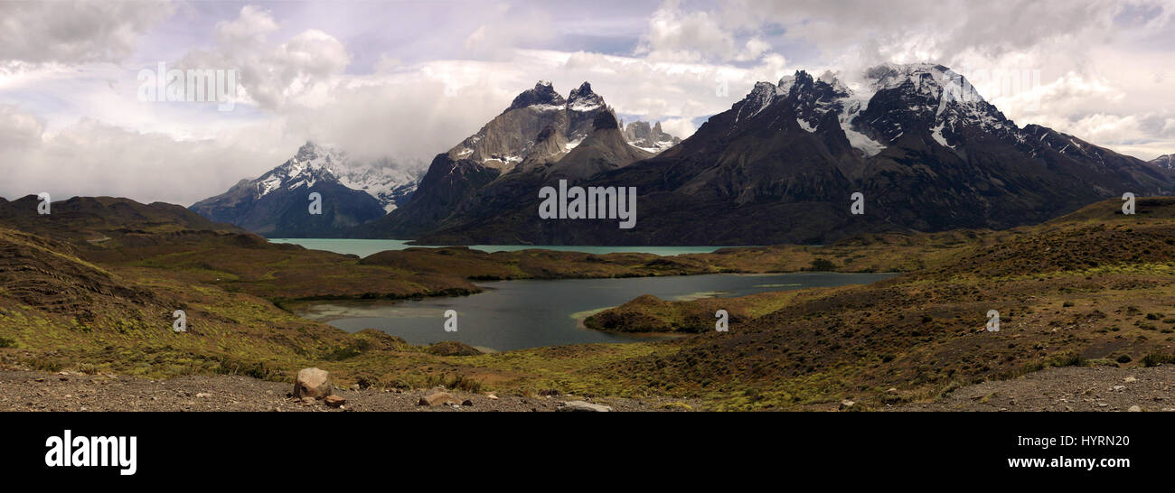 Stunning very wide panoramic view of mountains with a lake Stock Photo