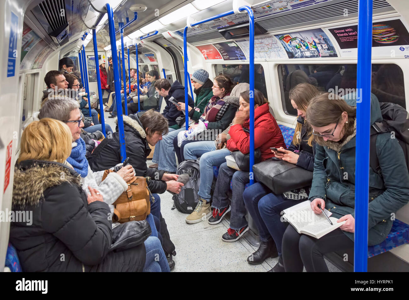 Passengers on London Underground Tube system, England, UK - Stock Image