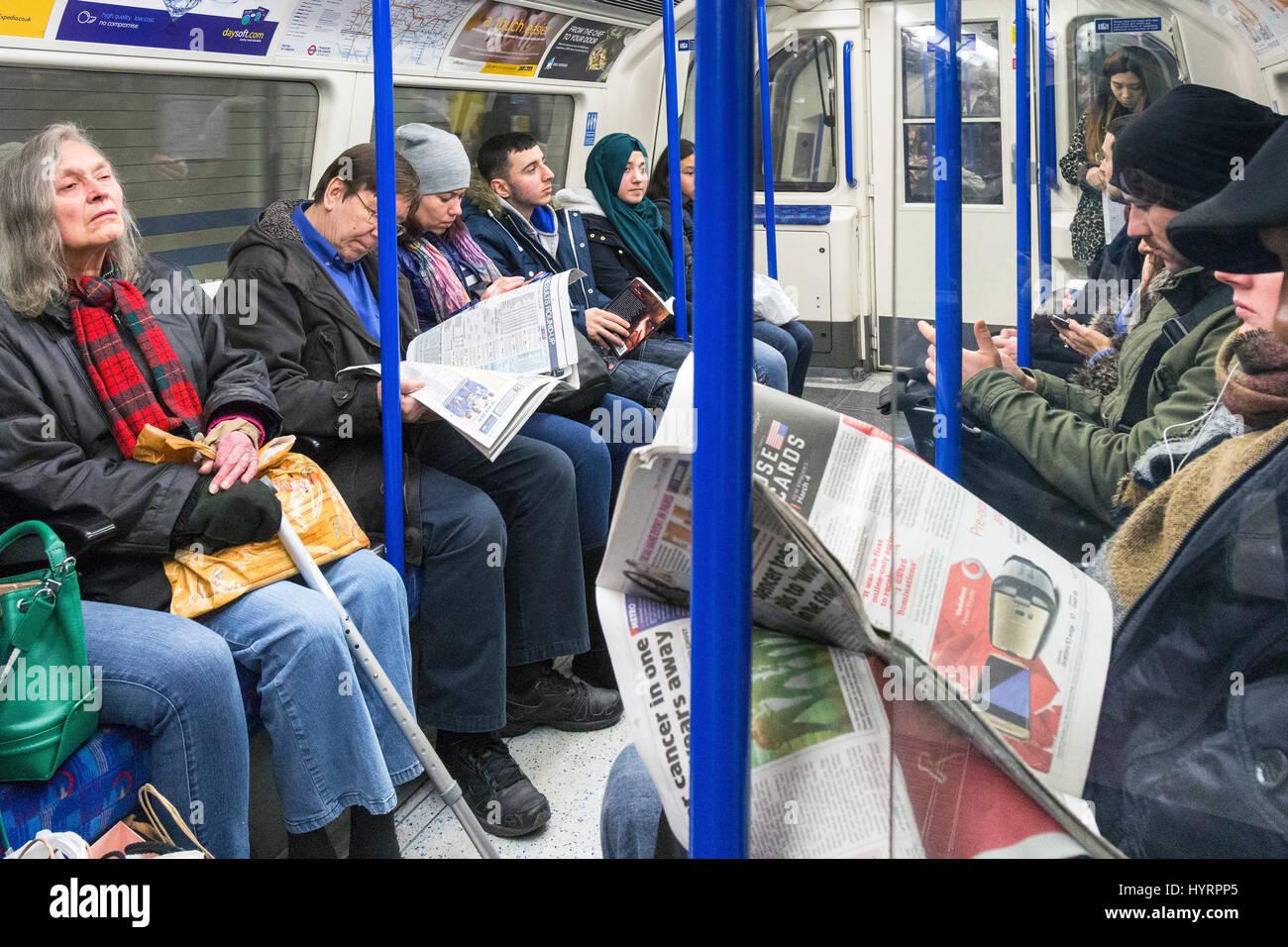 Passengers on London Underground Tube system, England, UK - Stock Image
