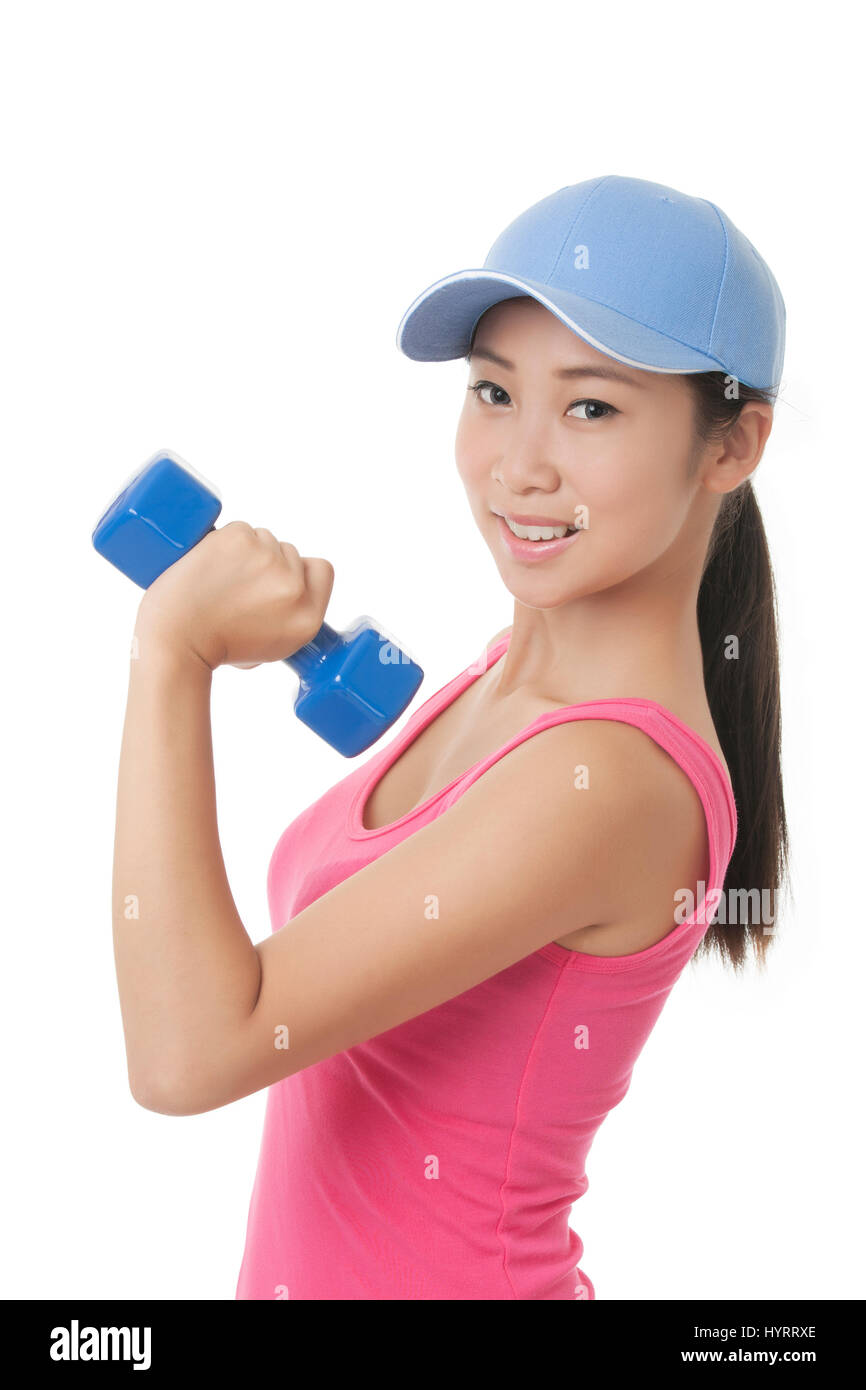 Beautiful Chinese  teenager working out using dumbbell weights isolated on a white background - Stock Image