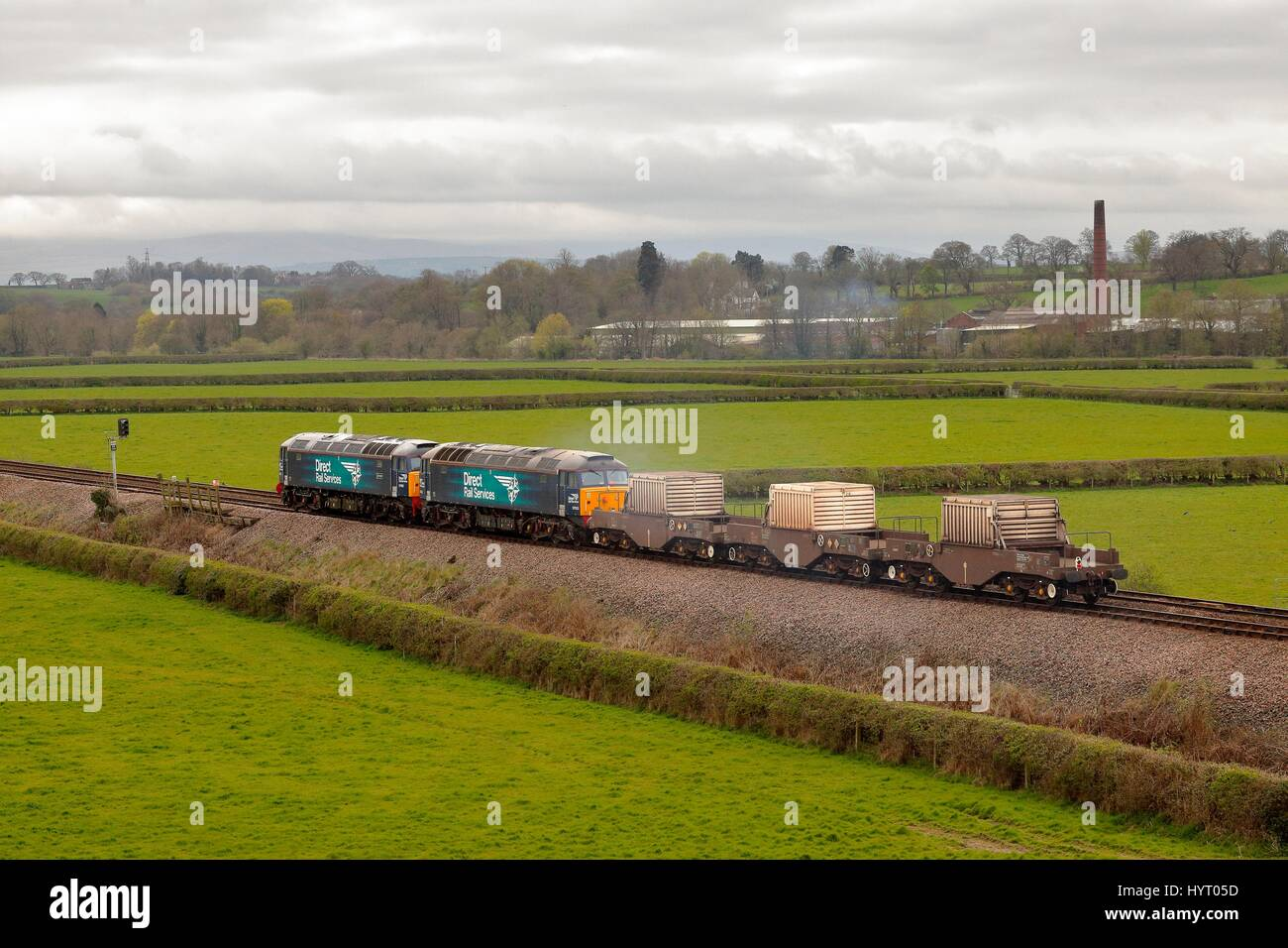 Nuclear waste transported in transport cabin containing a nuclear waste flask by Direct Rail Services Class 57 freight - Stock Image