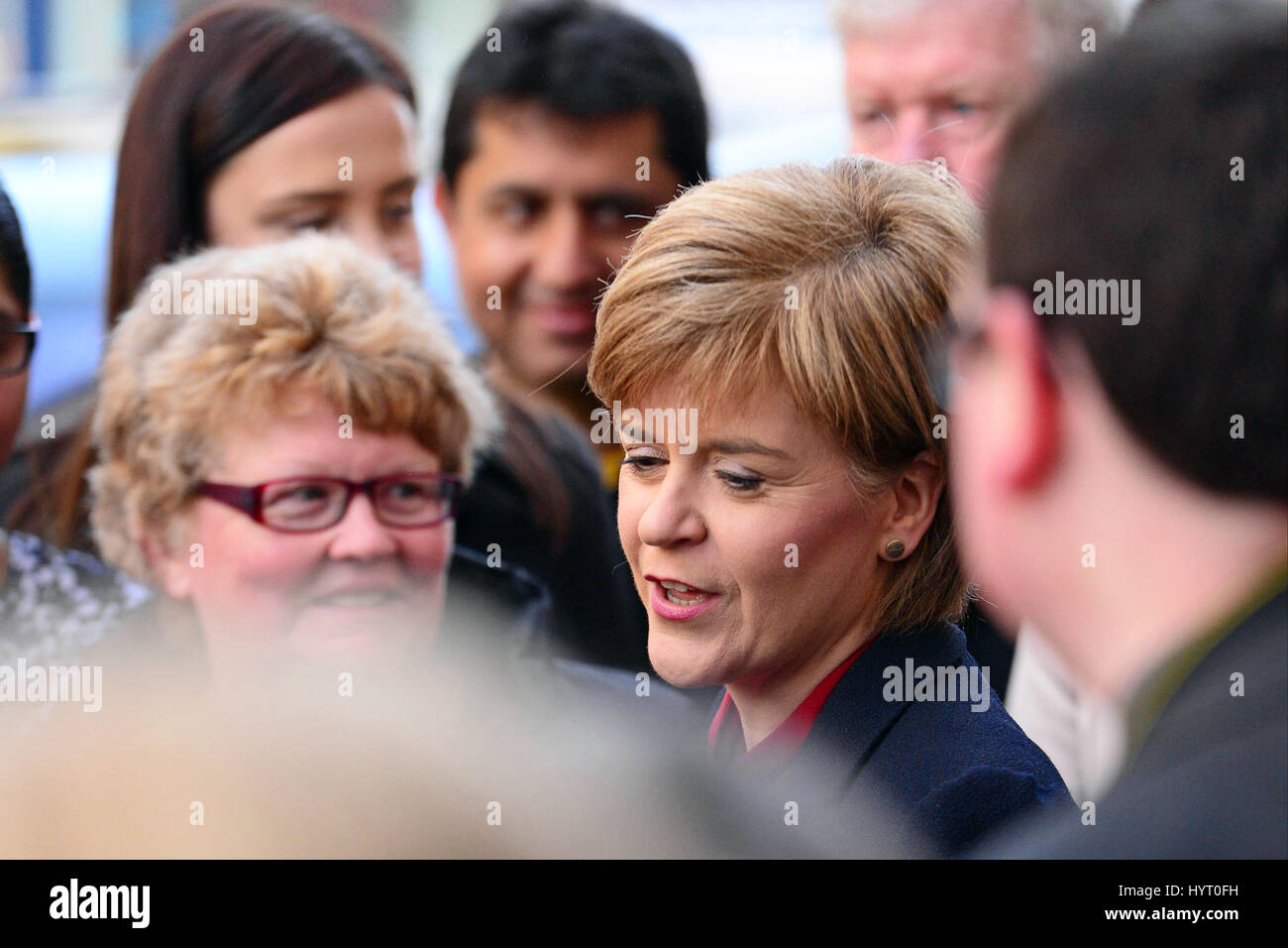 SNP leader and First Minister Nicola Sturgeon in the midst a crowd of well-wishers on a walkabout in Dunfermline - Stock Image