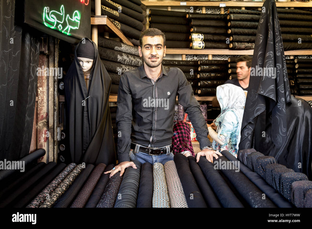 ISFAHAN, IRAN - AUGUST 20, 2016: Islamic outfit seller (hijab, veils and scarfs) in Isfahan bazaar  Picture of a - Stock Image