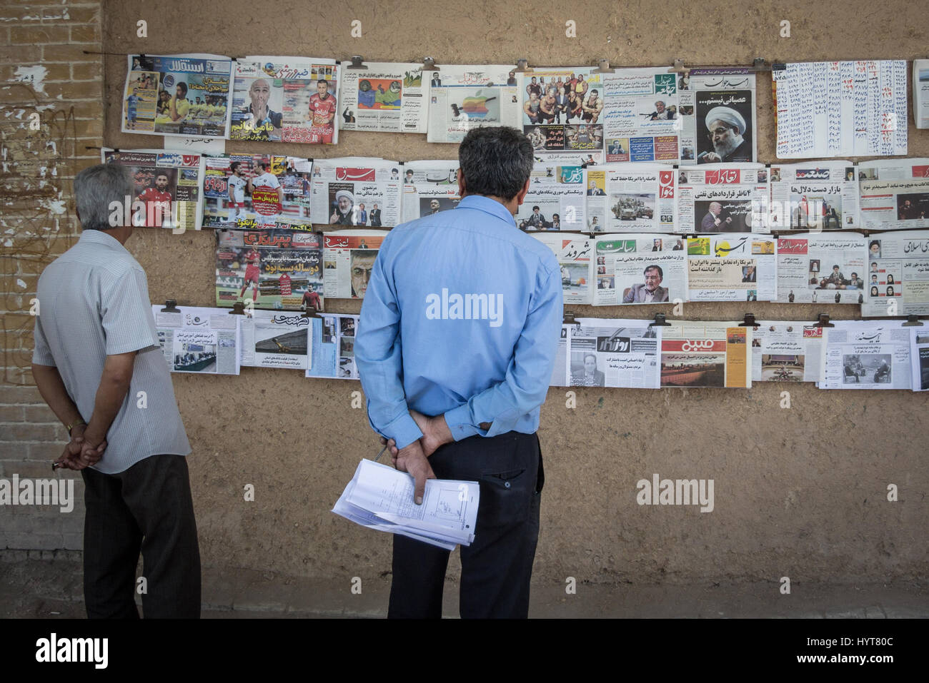 It is customary in some regions of Iran to hang newspapers in order for people to check their contents before buying. - Stock Image