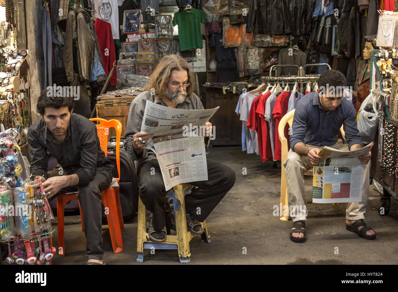 TEHRAN, IRAN - AUGUST 14, 2016: Iranian merchants reading newspapers in Farsi in Tehran main bazaar  Picture of Stock Photo