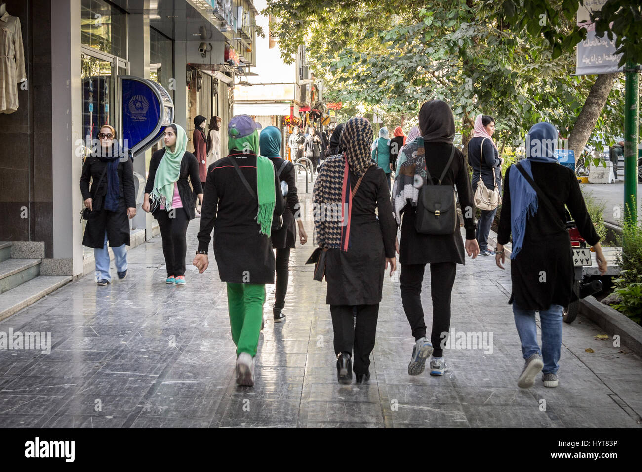 ISFAHAN, IRAN - AUGUST 20, 2016: Women wearing the islamic scarf walking in the streets of Isfahan, Iran  Picture - Stock Image