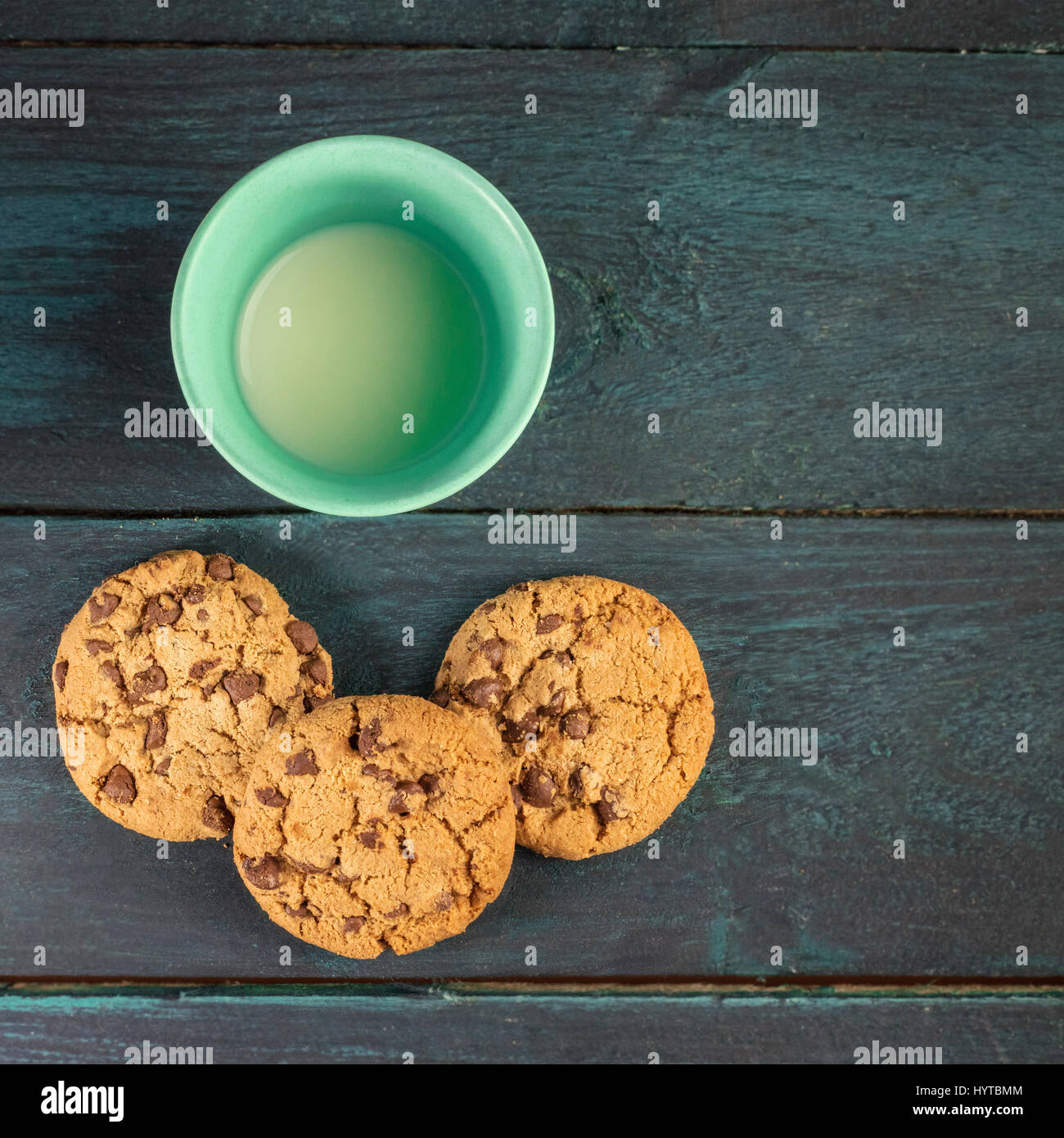 Chocolate chips cookies with glass of milk and copyspace - Stock Image