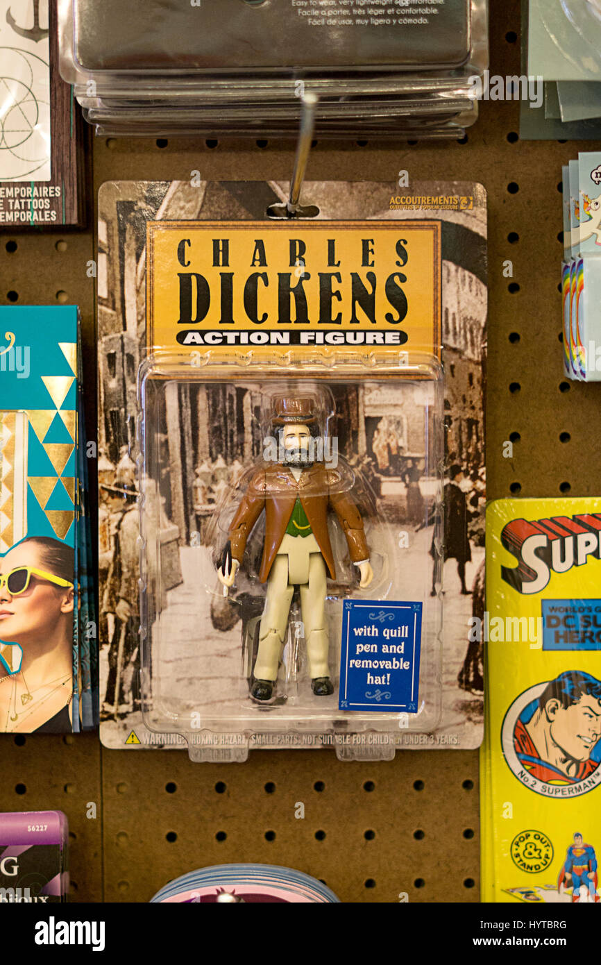 A Charles Dickens action figure for sale at Reminiscence vintage clothing and knickknack store on Fifth Avenue in - Stock Image