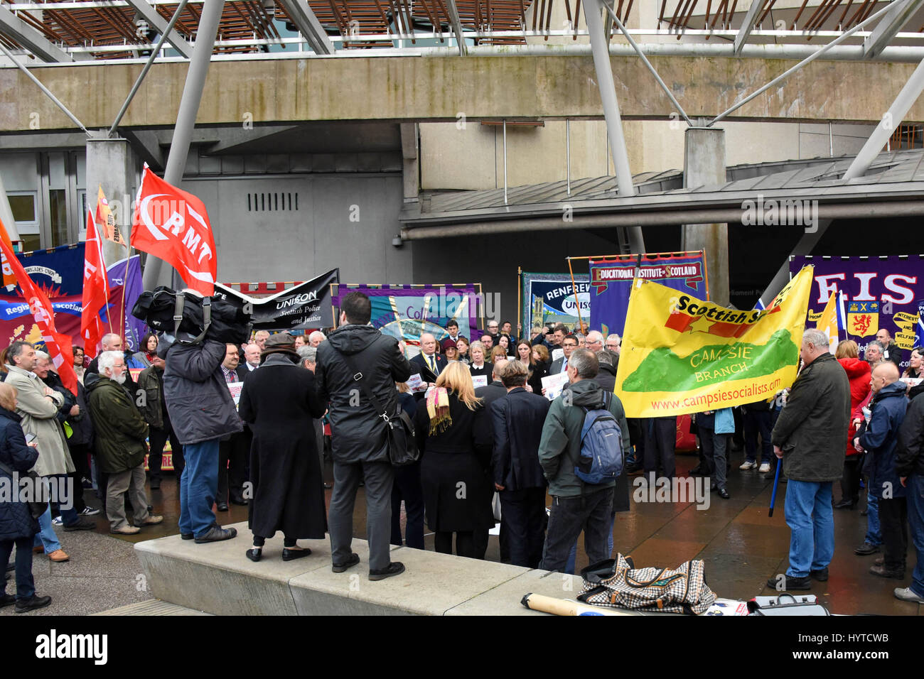 Trades Unions members rally outside the Scottish Parliament in a protest against the UK Government's Trade Union - Stock Image