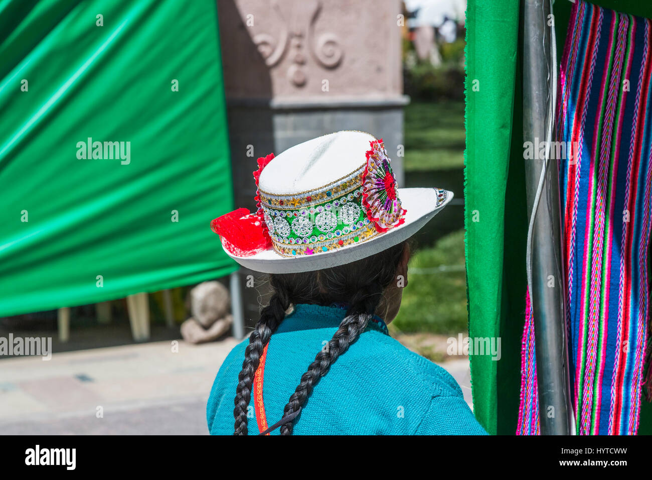 Local woman wearing traditional embroidered hat with rosette, Chivay, a town in the Colca valley, capital of Caylloma - Stock Image