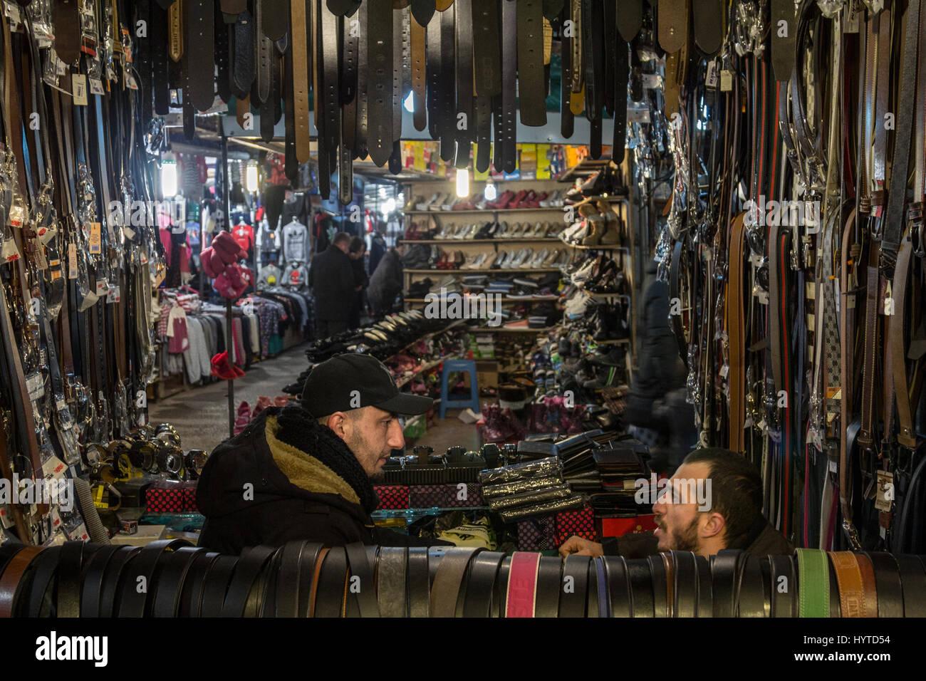 GJILAN - GNJILANE, KOSOVO - JANUARY 02, 2016: Salesmen in the local bazaar selling belts Stock Photo