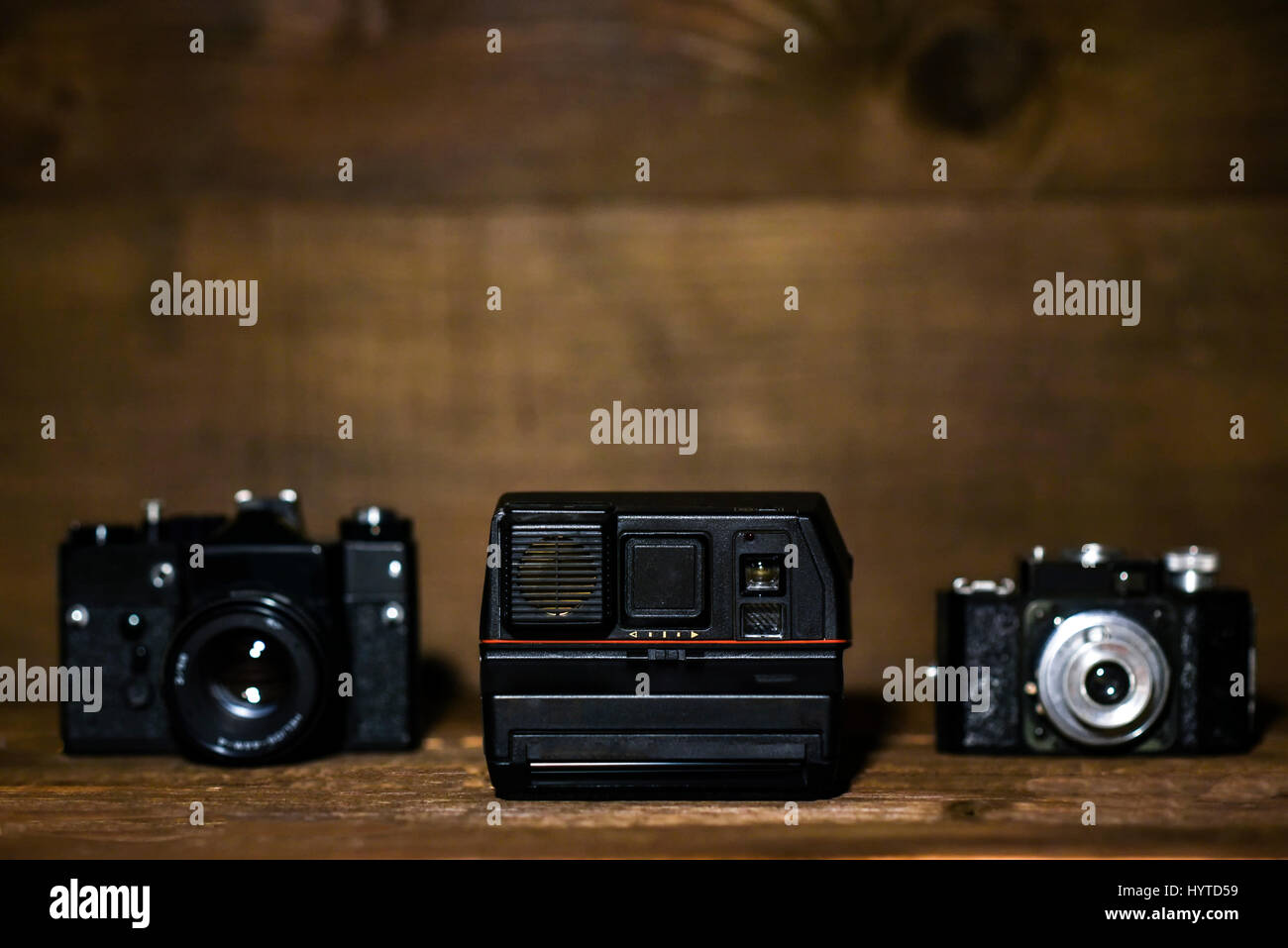 Olda cameras on a wooden background with copy space Stock Photo