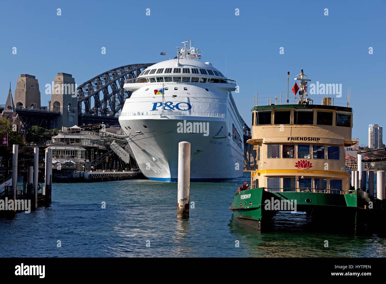 P&O Pacific Jewel cruise and City ferry at Circular Quay, Sydney Harbour Bridge background, Australia - Stock Image