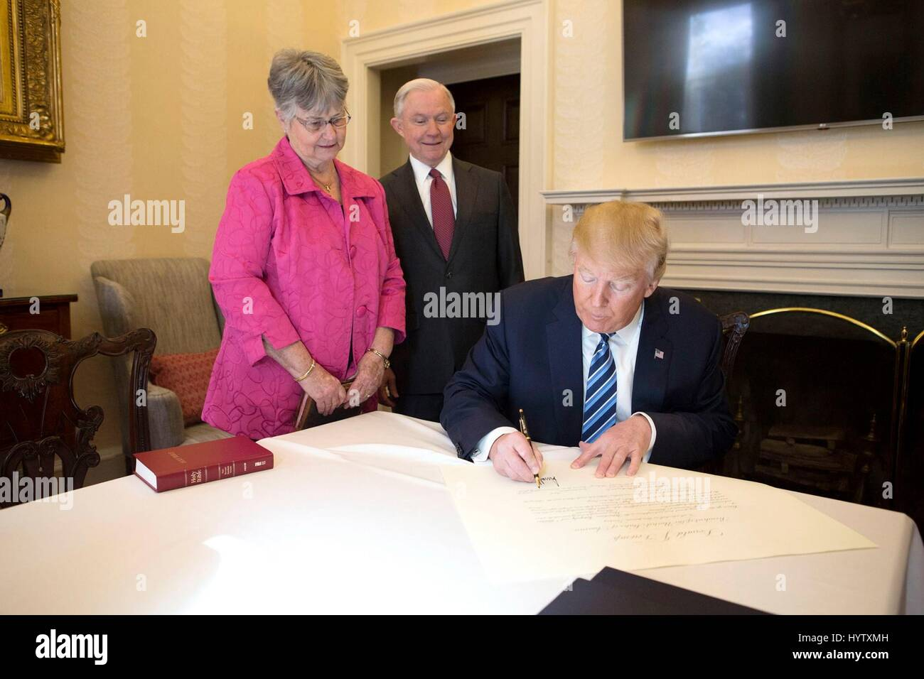 U.S President Donald Trump signs the papers certifying Sen. Jeff Sessions as the new Attorney General as his wife - Stock Image
