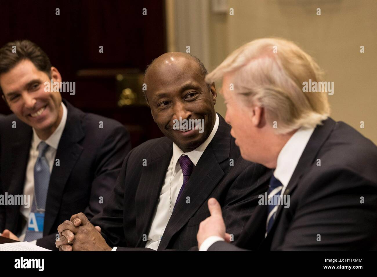 U.S President Donald Trump speaks to Kenneth Frazier, chairman and CEO of Merck & Co., during a meeting with - Stock Image