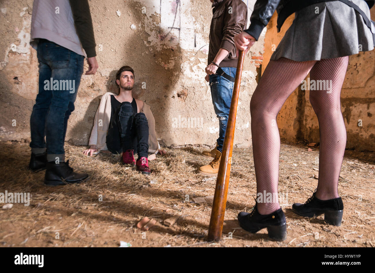 Gay boy surrounded by homophobic people - Stock Image