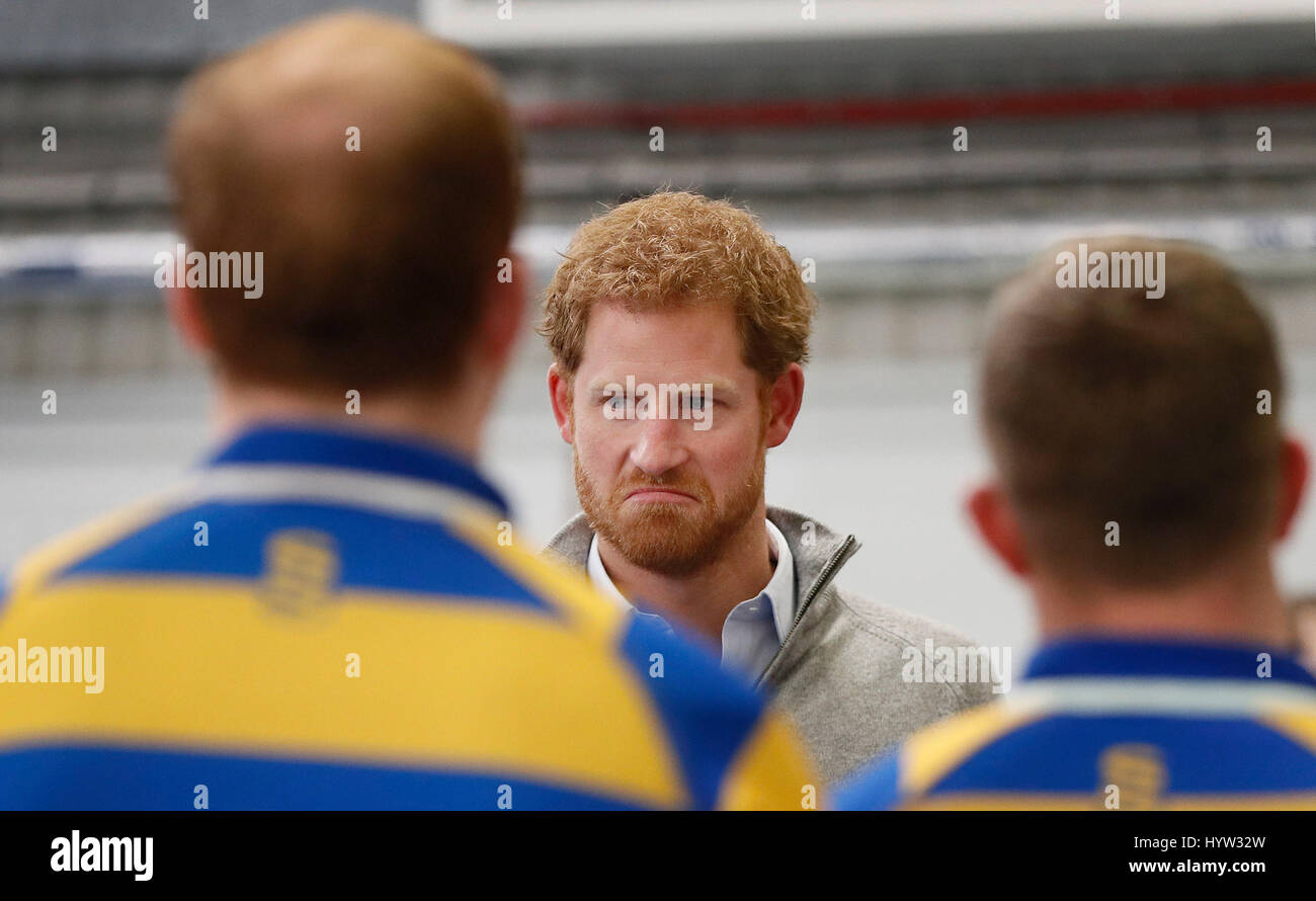 Prince Harry speaks to members of Bath University Rugby team after they demonstrated a scrummage machine used for - Stock Image