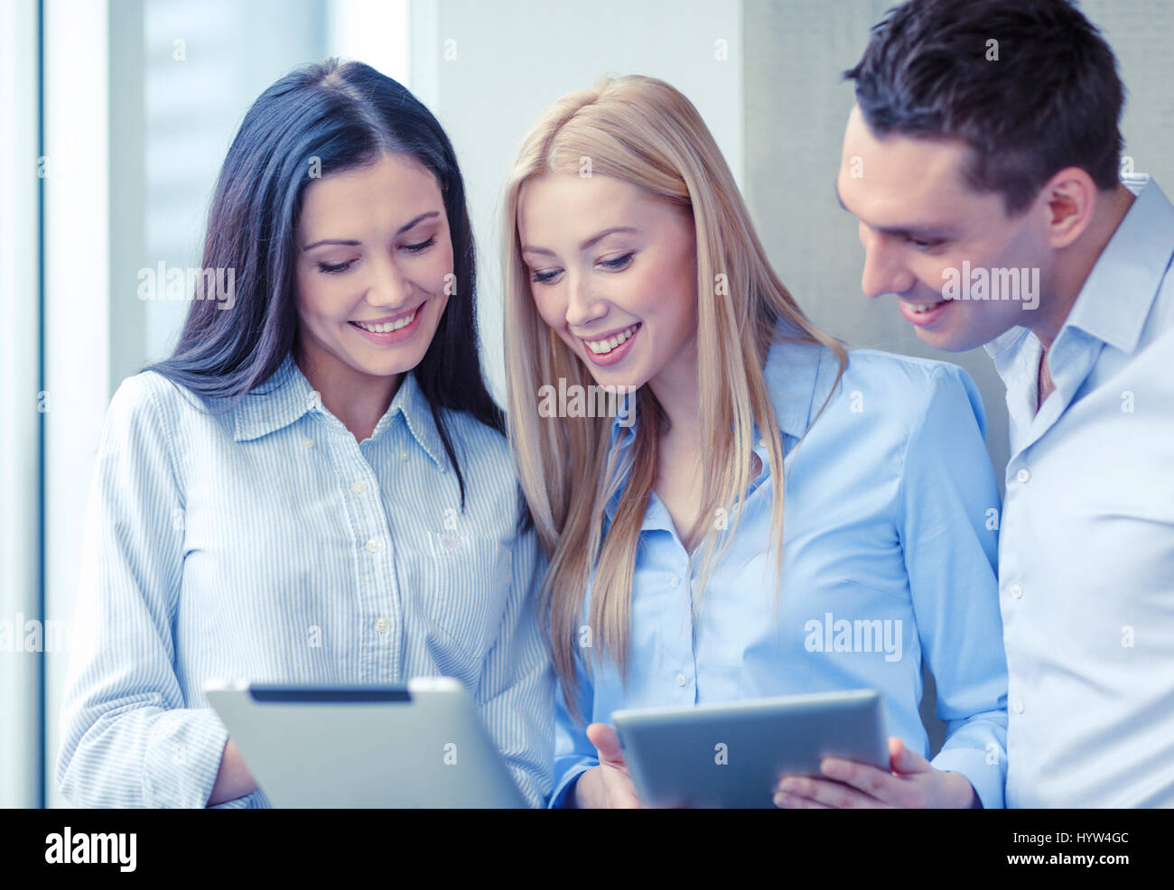 business team working with tablet pcs in office Stock Photo