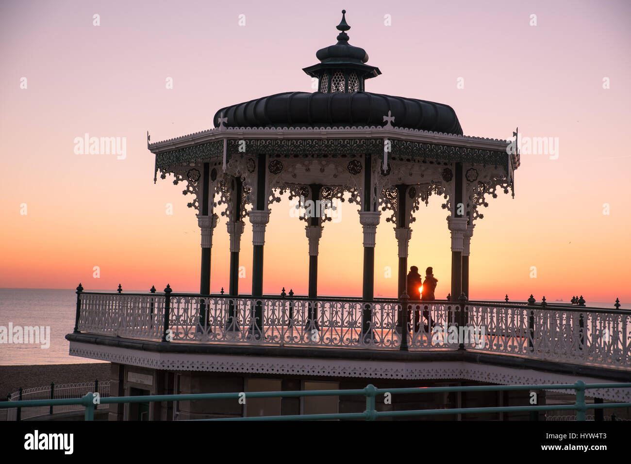 1st december, 2016, Brighton, UK. People watchiong the sunset from Brighton Bandstand - Stock Image