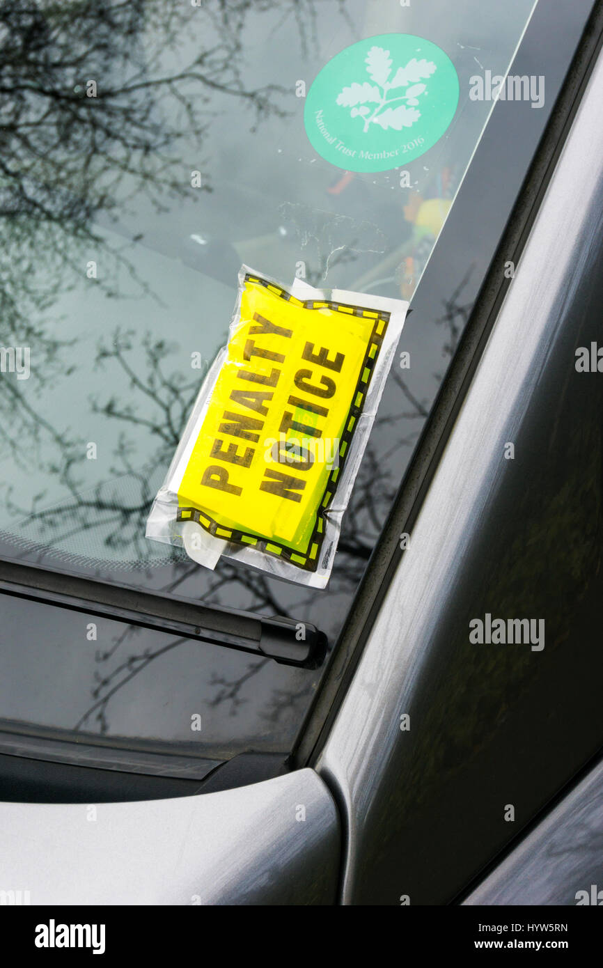 A parking ticket Penalty Notice stuck on a car's windscreen. - Stock Image