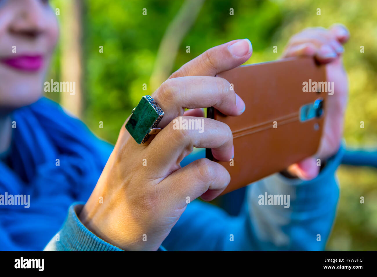 Close Up View of Woman Taking a Photograph with a Cellphone - Stock Image