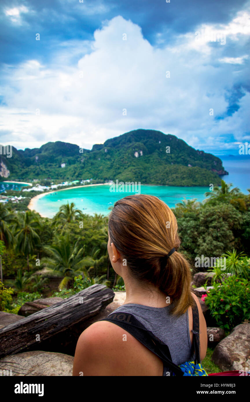 Rear View of Young Woman Looking From Island Viewpoint - Stock Image