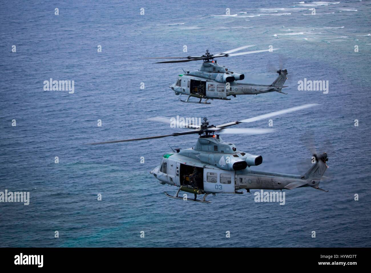 Owinawa, Japan. 26th Apr, 2017. Two U.S. Marine Corps UH-1Y Huey helicopters, with Marine Light Attack Helicopter Stock Photo