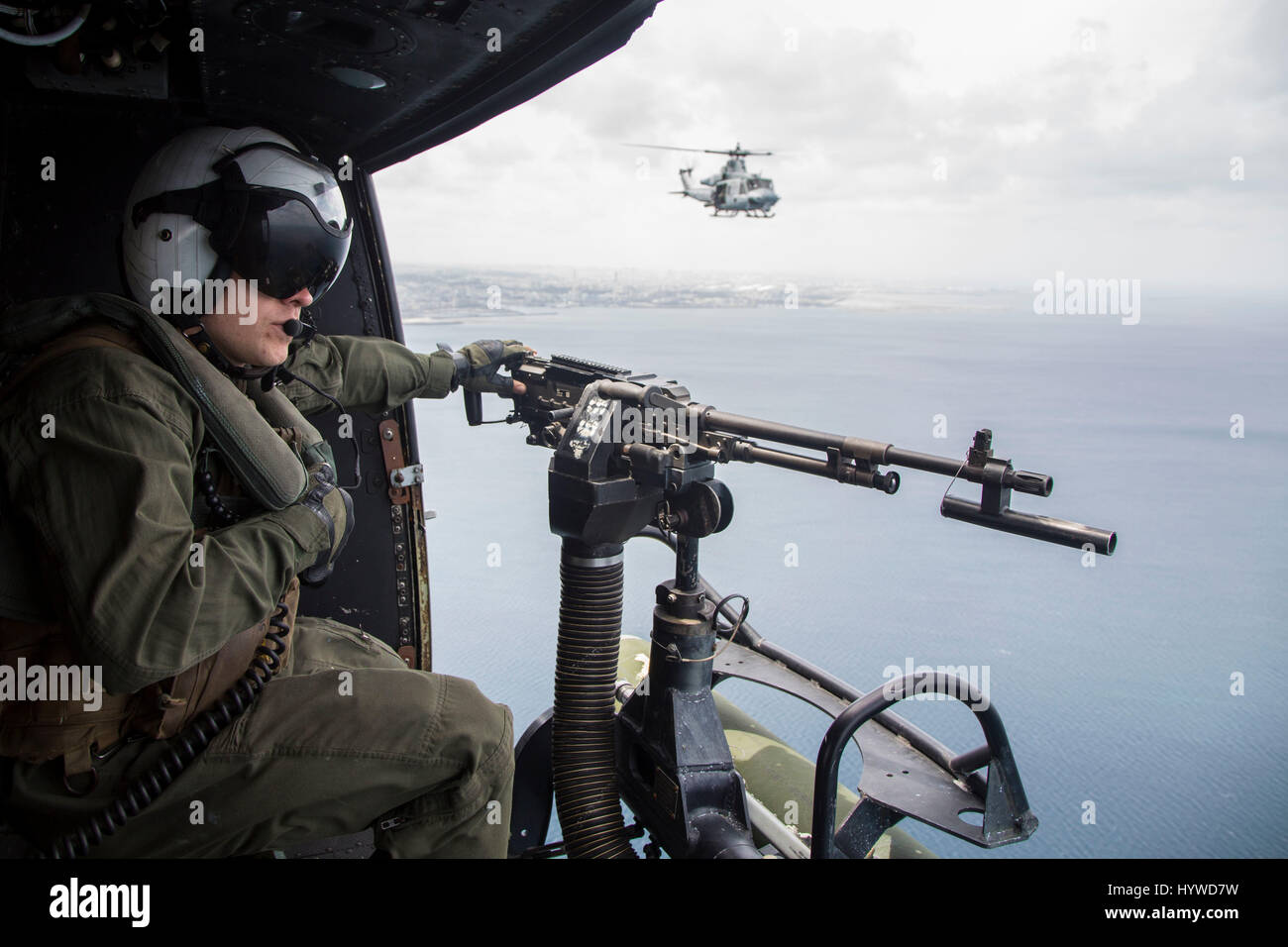 Owinawa, Japan. 26th Apr, 2017. U.S. Marine Corps crew chief Cpl. Justin Fry, mans the door gun on a UH-1Y Huey Stock Photo