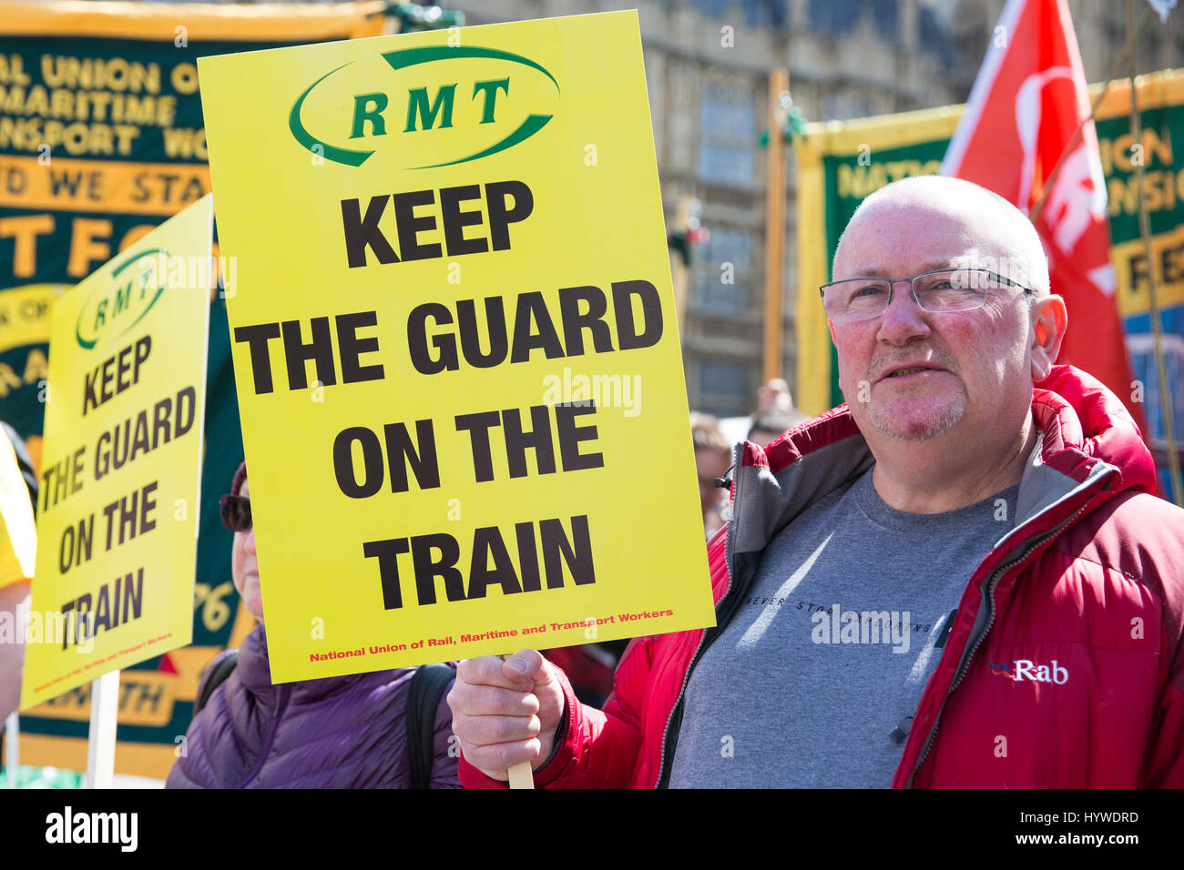 London, UK. 26th Apr, 2017. Members of the RMT union protest outside Parliament to mark the first anniversary of - Stock Image