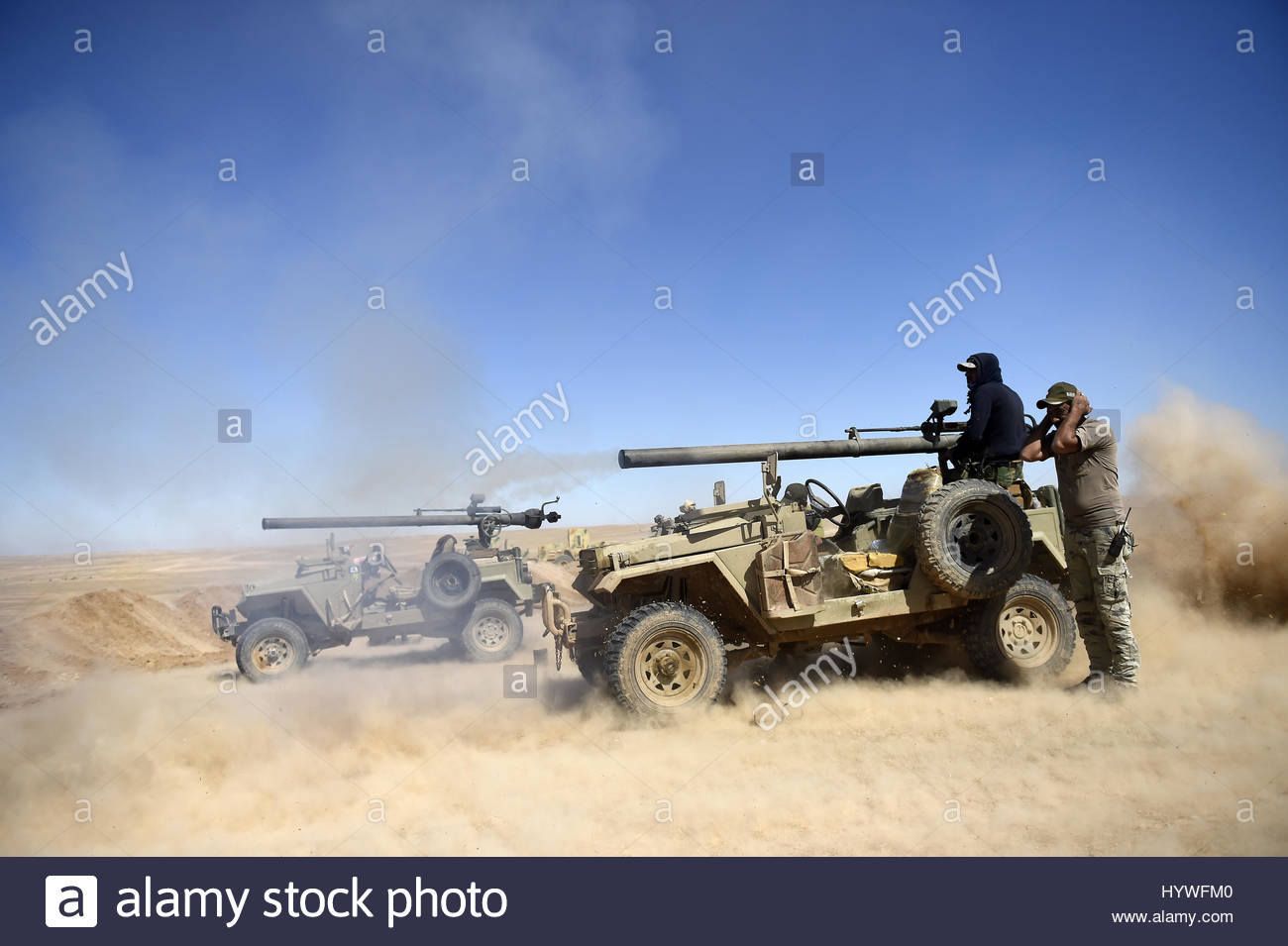 Hatra, Iraq. 26th Apr, 2017. Iraqi pro-government forces from Popular Mobilization Units (PMU) advance towards the - Stock Image