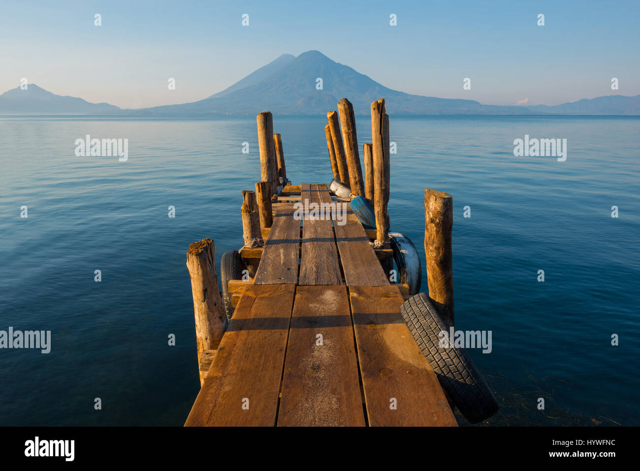 Sunset by the Atitlan Lake with an embarkation pier used by fishermen close to Panajachel, Guatemala. - Stock Image