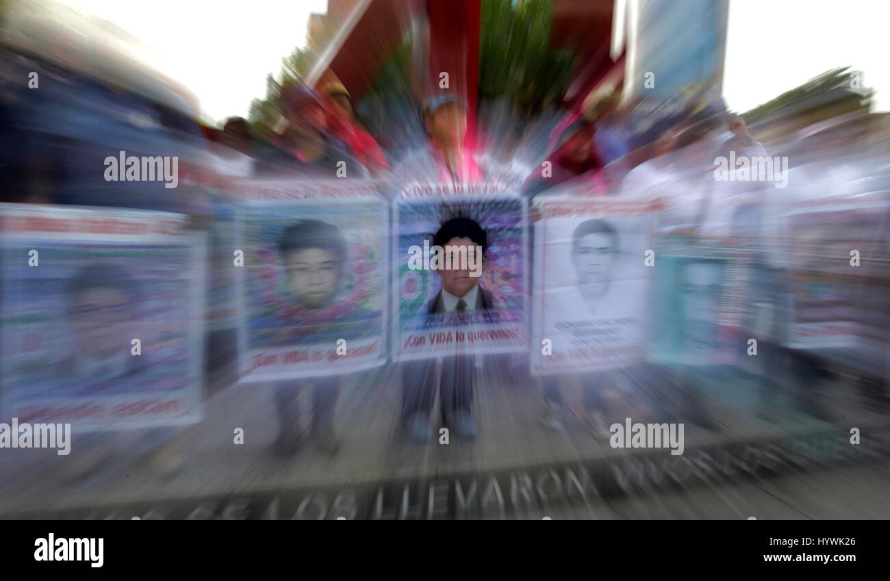 Parents of the 43 disappeared students from Ayotzinapa accompanied by students and activists march in Mexico City, - Stock Image