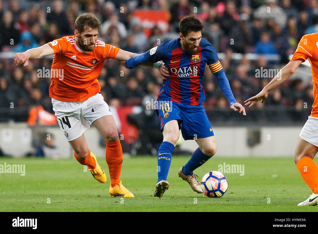 Barcelona, Spain. 26th Apr, 2017. Barcelona's Lionel Messi (R) vies with Osasuna's Fausto during the Spanish - Stock Image