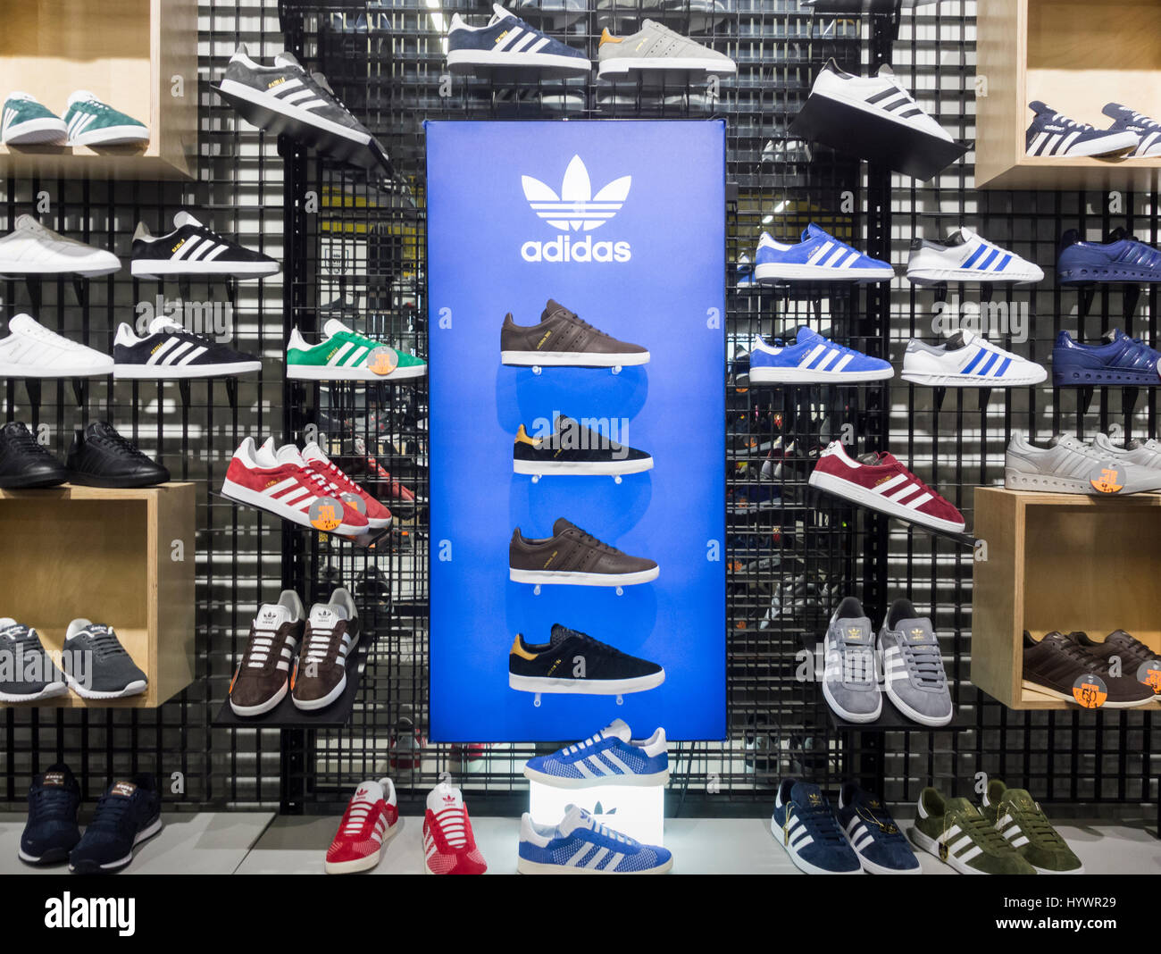 6aade89fd2c JD Sports store. UK. Adidas tainers running shoes display - Stock Image