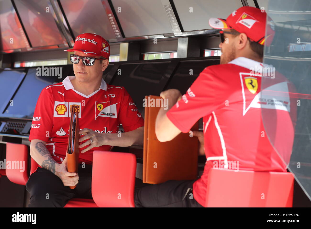 78223bdf7c51a6 27th Apr, 2017. Scuderia Ferrari F1 team drivers Kimi Raikkonen (L) of  Finland and Sebastian Vettel of Germany seen ahead of a free practice  session of the ...