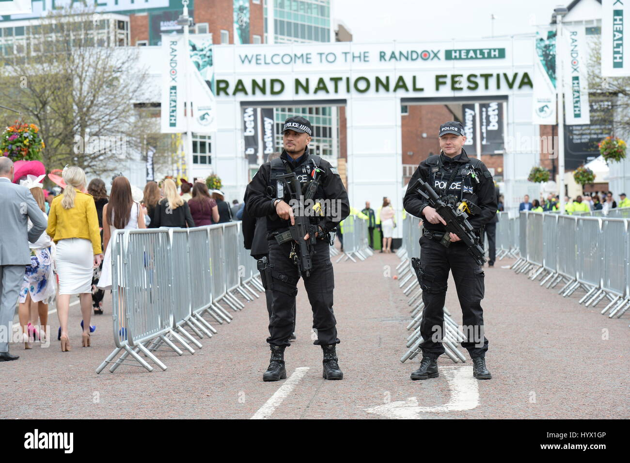 Liverpool, UK. 07th Apr, 2017. Armed Police keep an eye on guests as they arrive for Ladies Day at Aintree Racecourse, Stock Photo