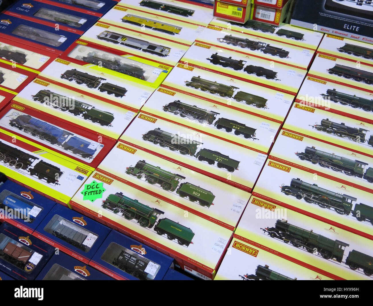 Rows of modern electric train set locomotives cars on display at a Vintage Toy Fair at Bath & West Showground, Somerset, Stock Photo