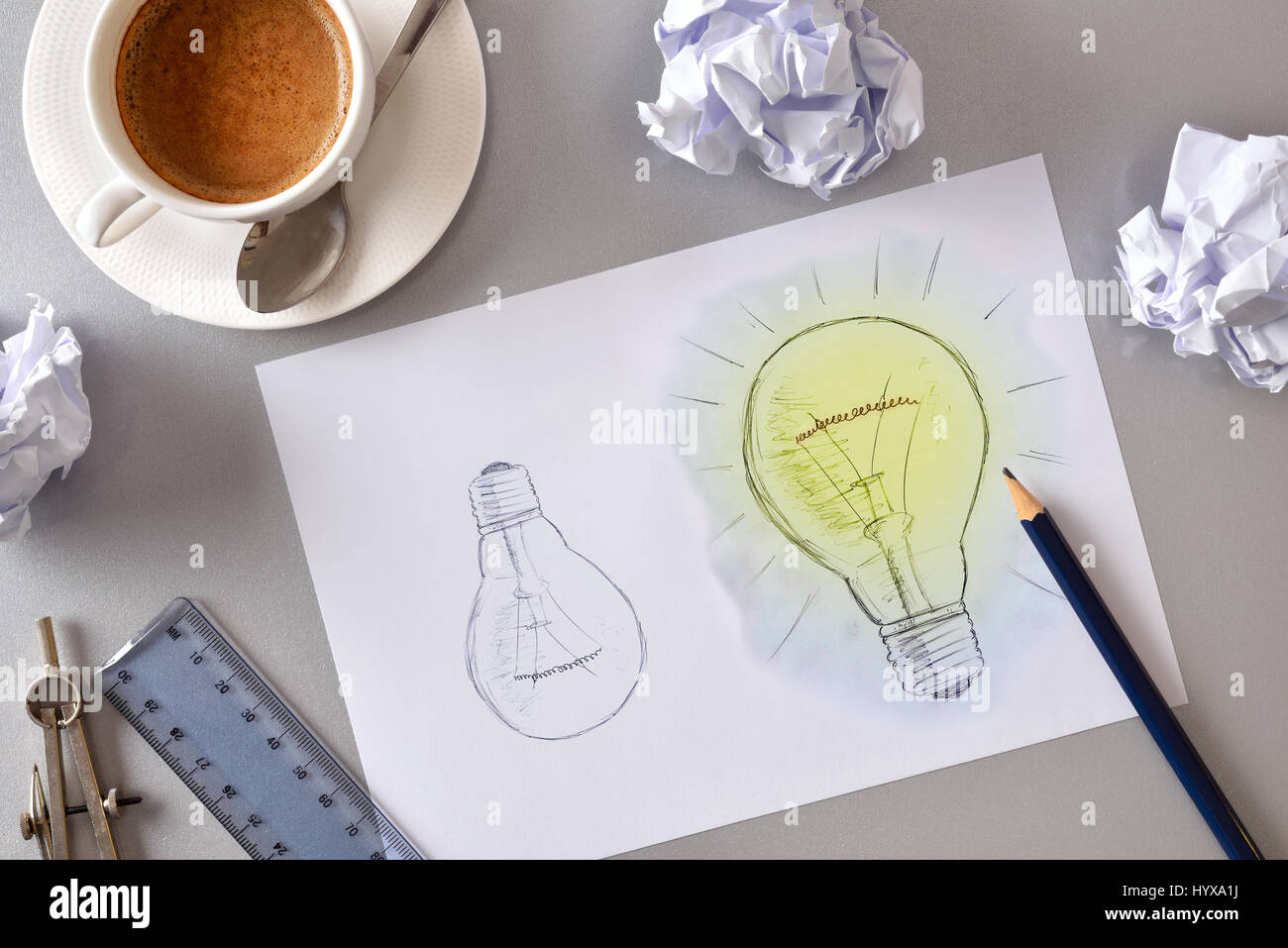 Concept of business idea with representation of the development of a plan with two bulbs drawn on a sheet. With - Stock Image