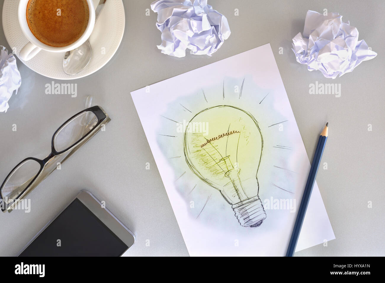 Concept of business idea with representation of the development of a plan with bulb drawn on a sheet. With pencil, - Stock Image