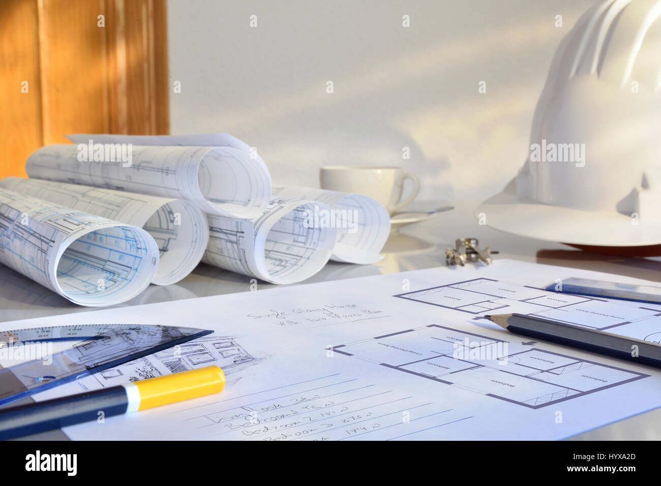 Working table of a construction engineer with plan of a project working table of a construction engineer with plan of a project blueprints and tools background front view horizontal composition malvernweather Images
